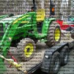 Стяжные цепи с натяжителями и ремнями страхуют трактор на платформе-прицепе